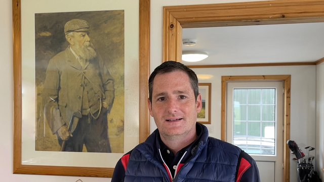 Gary Young in Askernish clubhouse with Old Tom Morris in background