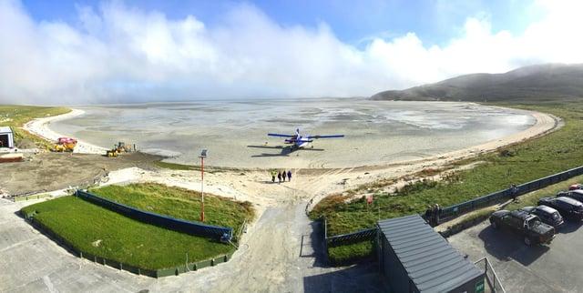 A flight lands at Barra