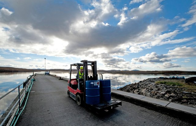 Forklift in operation outside the factory, located on Callanish pier