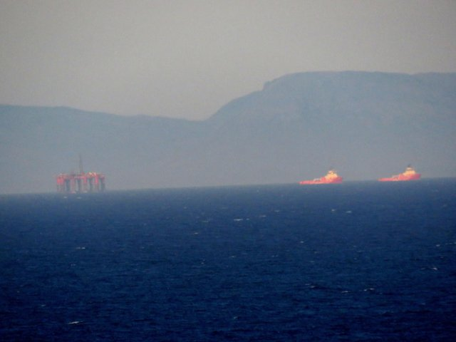 """The """"Northern Producer"""" oilrig just off the Butt of Lewis on a hazy morning. The Sutherland hills form an impressive backdrop."""