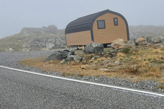 Abandoned by the roadside... the camping pods are so large that they couldn't get past the grid into the village