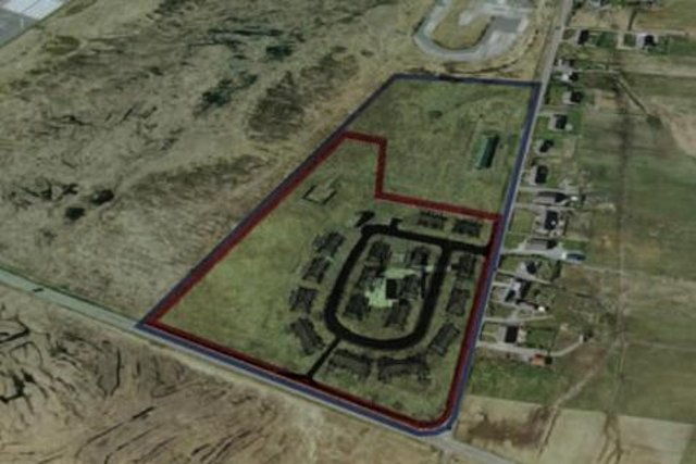 The land which was granted approval for new homes.