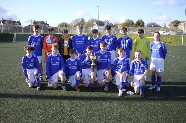 Back U15s with the Kemnay Cup after the match