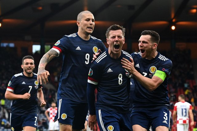 Scotland players mob Callum McGregor after his goal against Croatia (Pic by Paul Ellis/Getty Images)