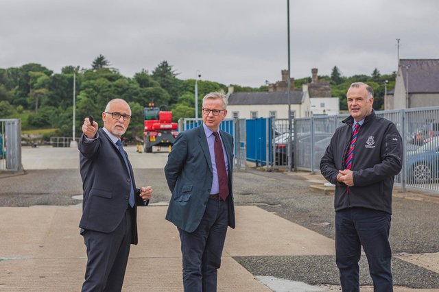 THE WAY AHEAD: Comhairle Leader Roddie MacKay and Alex MacLeod, chief executive of the port authority, show Michael Gove around the harbour. Pic: Fiona Rennie